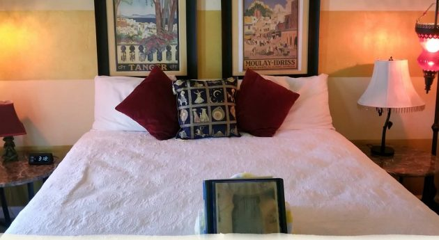 Deluxe King Room bed with pillows