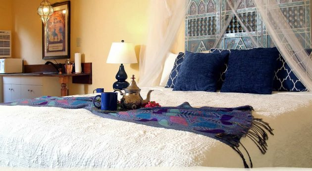 Private King Room bed with tea service and decorative pillows