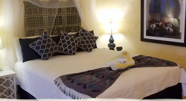 Private King Room bed with blanket